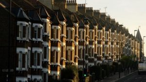 Row of houses on street in England - Hampton Relocation Blog